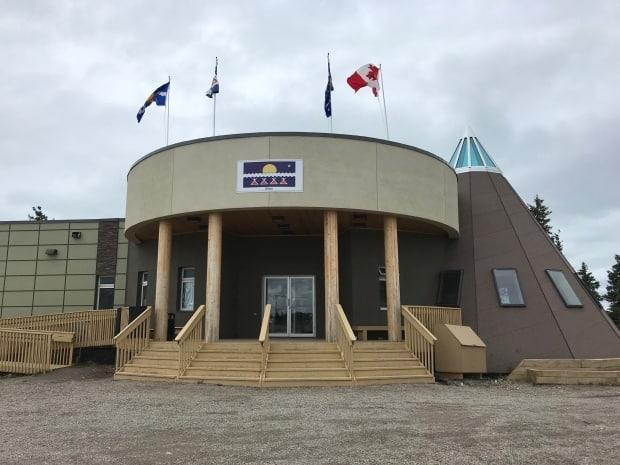 The Tlicho Government building in Whatì. The 17th annual Tłı̨chǫ Gathering will now be a virtual event, and Treaty 11 centennial celebrations have been postponed.  (Emily Blake/CBC - image credit)