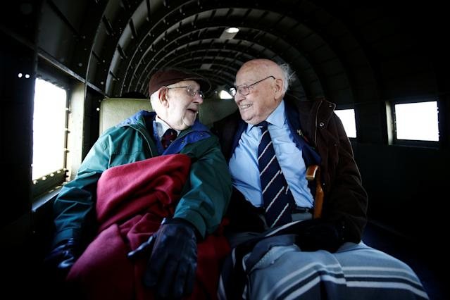 WWII veterans Roy Briggs and George Prichard sit onboard a C47 A Dakota plane used in the D-Day landings, during Remembrance Sunday celebrations in Dover, Britain, November 10, 2019. REUTERS/Henry Nicholls