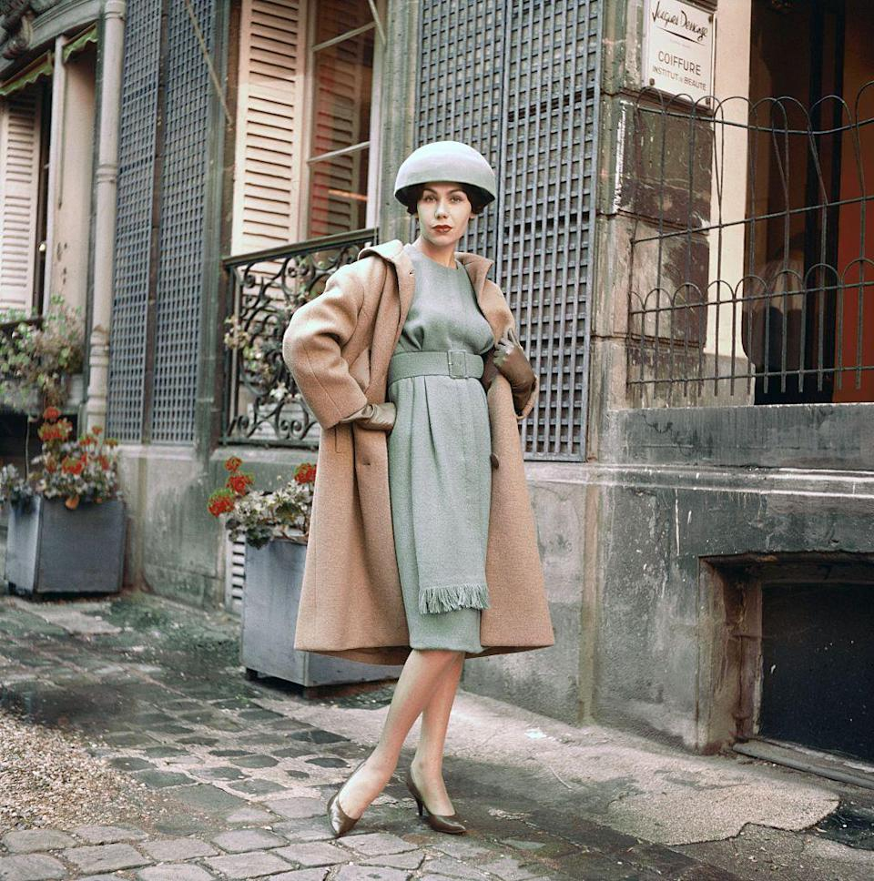 <p>Towards the end of the decade, designer Guy Laroche reinterpreted the wool coat trend (somewhat) by raising the waistline and adding fringe detailing to the front of the dress.<br></p>