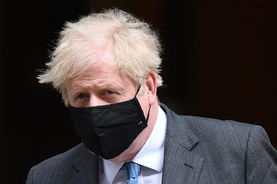 Britain's Prime Minister Boris Johnson, wearing a face mask to combat the spread of the novel coronavirus, leaves 10 Downing Street in central London on April 28, 2021, to take part in the weekly session of Prime Minister's Questions (PMQs) at the House of Commons. - Britain's Electoral Commission on Wednesday announced a formal investigation into how Prime Minister Boris Johnson paid for a lavish makeover of his Downing Street flat, seriously escalating a simmering scandal. (Photo by JUSTIN TALLIS / AFP) (Photo by JUSTIN TALLIS/AFP via Getty Images)