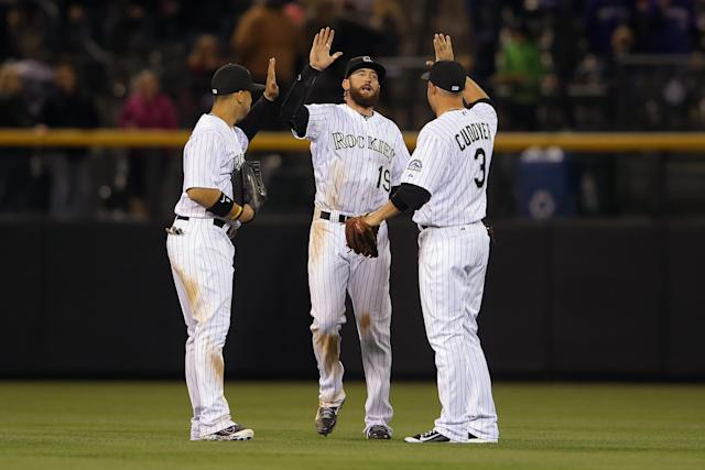 DENVER, CO - APRIL 05: Outfielders Carlos Gonzalez #5, Charlie Blackmon #19 and Michael Cuddyer #3 of the Colorado Rockies celebrate their victory over the Arizona Diamondbacks at Coors Field on April 5, 2014 in Denver, Colorado. The Rockies defeated the Diamondbacks 9-4. (Photo by Doug Pensinger/Getty Images)