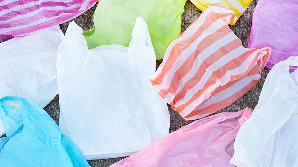 Colorful plastic waste on cement floor background