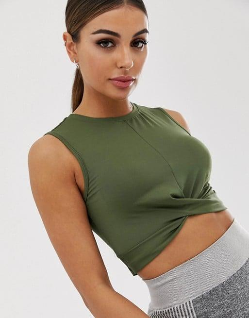 """<p>This fun <a href=""""https://www.popsugar.com/buy/ASOS-4505-Knot-Front-Cropped-Tank-Top-481216?p_name=ASOS%204505%20Knot%20Front%20Cropped%20Tank%20Top&retailer=us.asos.com&pid=481216&price=23&evar1=fit%3Aus&evar9=44665463&evar98=https%3A%2F%2Fwww.popsugar.com%2Ffitness%2Fphoto-gallery%2F44665463%2Fimage%2F46509823%2FASOS-4505-Knot-Front-Cropped-Tank-Top&list1=shopping%2Cworkout%20clothes%2Chealthy%20living%2Cunder%20%2425%2Caffordable%20shopping&prop13=mobile&pdata=1"""" rel=""""nofollow"""" data-shoppable-link=""""1"""" target=""""_blank"""" class=""""ga-track"""" data-ga-category=""""Related"""" data-ga-label=""""https://us.asos.com/asos-4505/asos-4505-knot-front-cropped-tank-top/prd/12072072?clr=khaki&amp;colourWayId=16387610&amp;SearchQuery=&amp;cid=27167"""" data-ga-action=""""In-Line Links"""">ASOS 4505 Knot Front Cropped Tank Top </a> ($23) looks much more expensive than it is.</p>"""