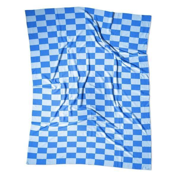 "<p>""Since checker is clearly the print of 2021, I've been stocking up left, right, and center. When I came across <span>Curio's Splash checkered blanket</span> ($372), I knew I had found the perfect new throw for my room. I love that it's made from 100 percent Australian merino wool, and the color is simply divine. This is one item I can't wait to buy.""</p>"