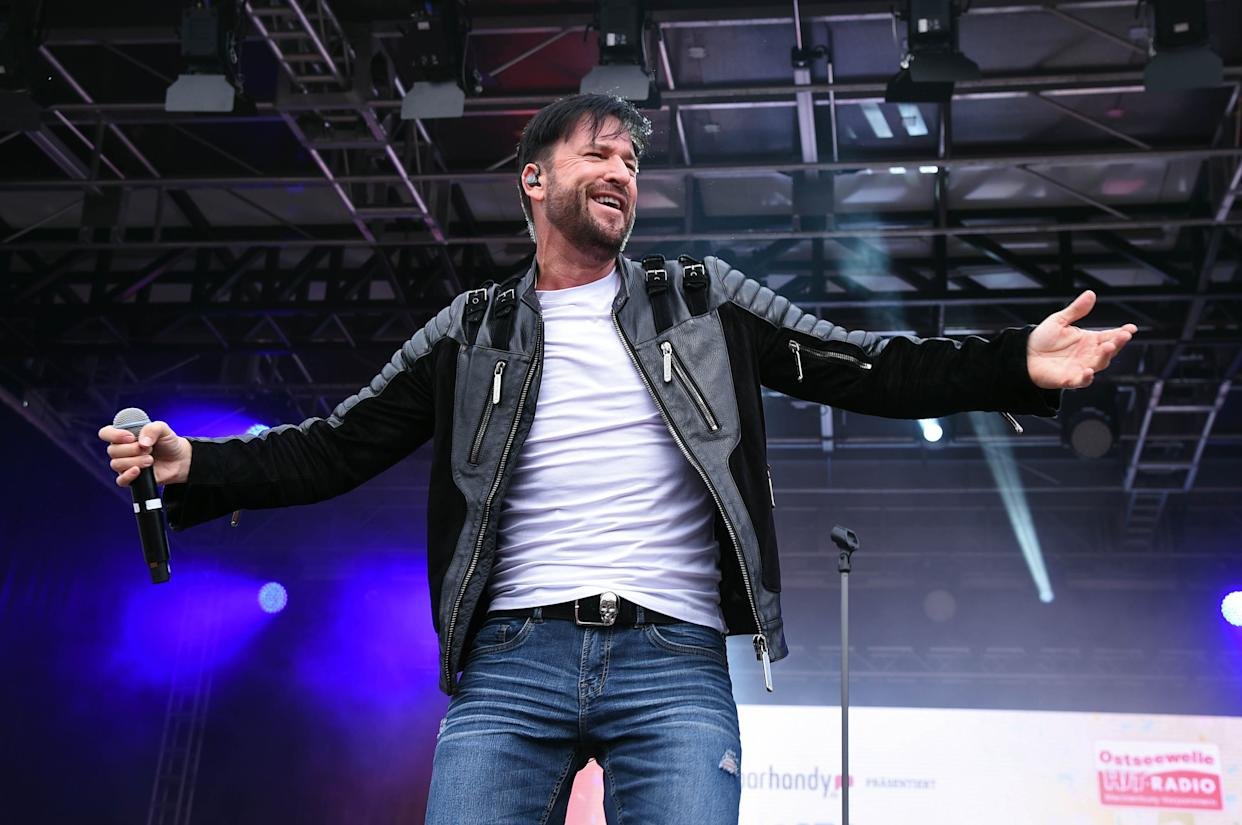 ROSTOCK, GERMANY - JULY 20: Michael Wendler performs onstage during the Rostock Ole Schlagerparty at IGA-Park on July 20, 2019 in Rostock, Germany. (Photo by Tristar Media/Getty Images)