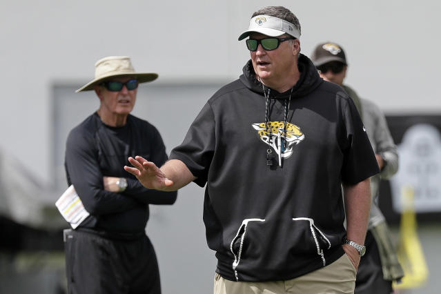 FILE - In this June 12, 2019, file photo, Jacksonville Jaguars head coach Doug Marrone, front, directs an NFL football practice, Wednesday, June 12, 2019, in Jacksonville, Fla., as Tom Coughlin, left, executive vice president of football operations for the Jaguars, looks on. Coughlin and Marrone are pretty much taking it easy on the Jaguars. It's a complete about-face for two old-school coaches who seem to take pleasure in grinding guys into the ground. (AP Photo/John Raoux, File)