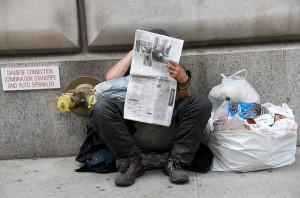 Bum reading the papers