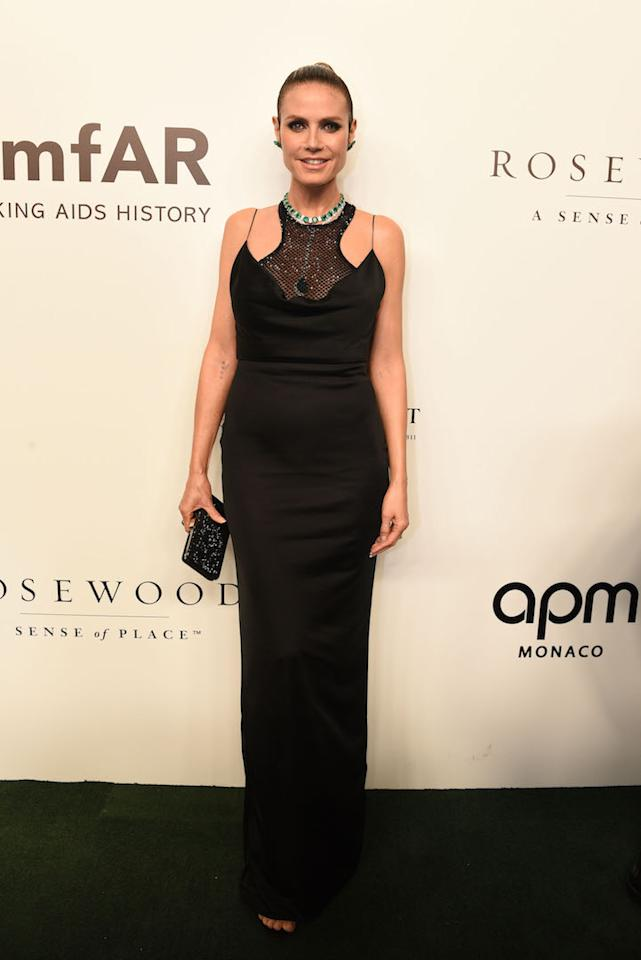 <p>Heidi Klum chose a silky Versace dress finished with Jimmy Choo shoes and Lorraine Schwartz jewellery for a recent red carpet outing. <em>[Photo: Getty]</em> </p>