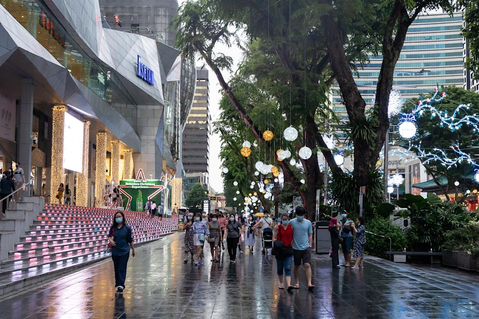 Shoppers along Singapore's Orchard Road in preparation for the festive season.