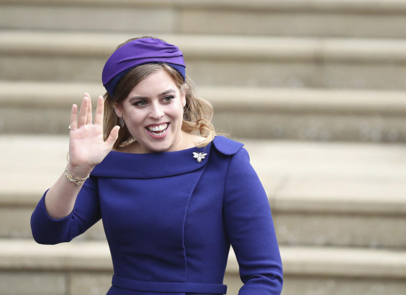 Britain's Princess Beatrice arrives for the wedding of Princess Eugenie of York and Jack Brooksbank at St George's Chapel, Windsor Castle, near London, England. Buckingham Palace announced Friday Feb. 7, 2020, that Queen Elizabeth II's granddaughter Princess Beatrice will marry Edoardo Mapelli Mozzi in London on May 29. (Steve Parsons/Pool via AP, File)