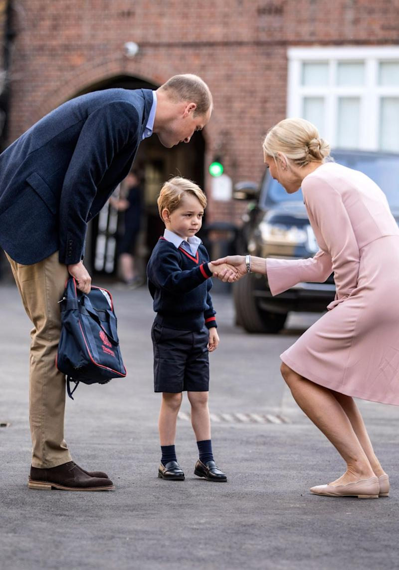 Prince George was greeted by Ms Helen Haslem Head of Lower School on his first day as he was accompanied by his father Prince William. Source: Getty