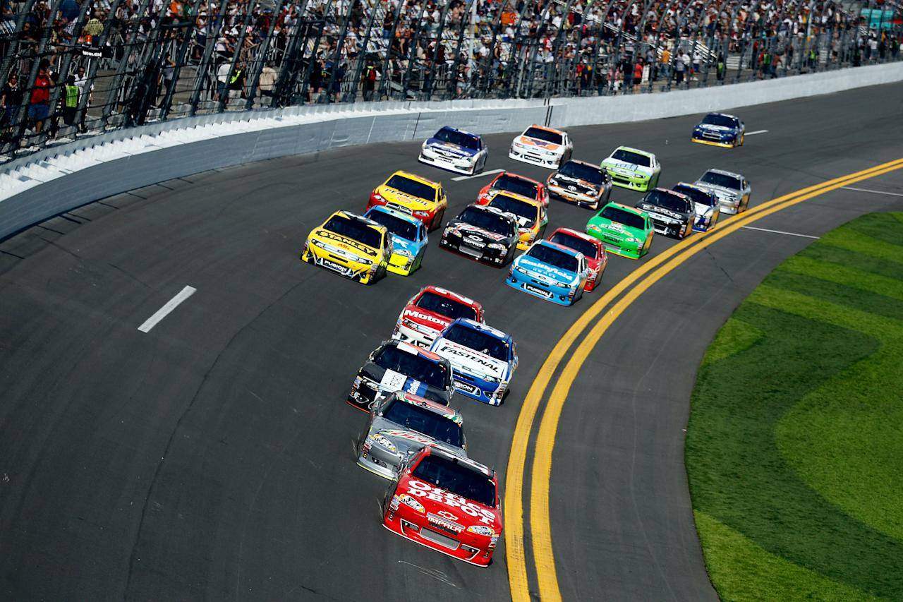 DAYTONA BEACH, FL - FEBRUARY 23:  Tony Stewart, driver of the #14 Office Depot/Mobil 1 Chevrolet, leads the field during the NASCAR Sprint Cup Series Gatorade Duel 1 at Daytona International Speedway on February 23, 2012 in Daytona Beach, Florida.  (Photo by Chris Graythen/Getty Images)