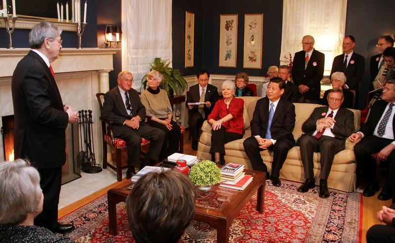 FILE PHOTO: Iowa Governor Terry Branstad (L) makes a few remarks to China's Vice President Xi Jinping
