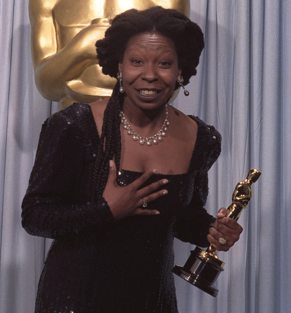 """Whoopi Goldberg holds her Oscar for Best Supporting Actress, won for her role in """"Ghost,"""" in Los Angeles in this March 26, 1991 photo.  Goldberg's Oscar statuette was stolen after it was sent out for cleaning, but was recovered Tuesday, Feb. 5, 2002, the academy said. (AP Photo/ Bob Galbraith)"""