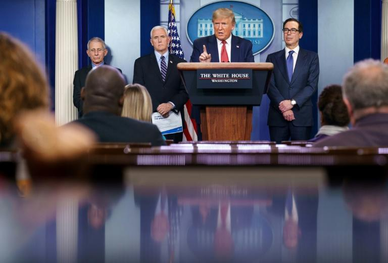 US President Donald Trump appears every day, alongside government experts, for a briefing seen by millions of people (AFP Photo/MANDEL NGAN)