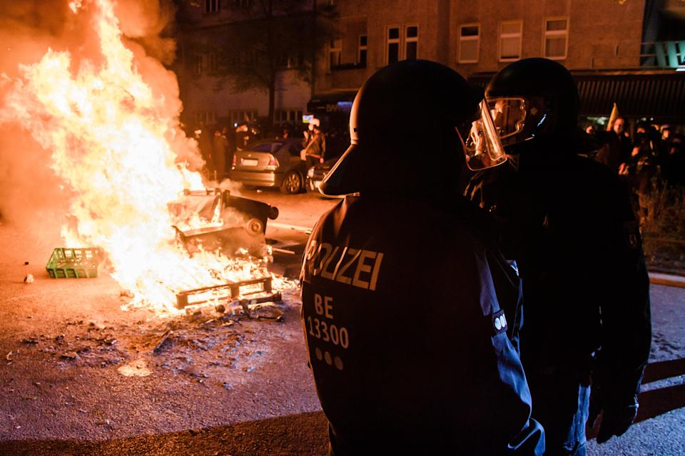 Riot police take position next to a burning barricade during a protest on May Day in Berlin, GermanyEPA