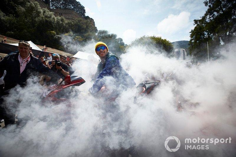 """Lewis Hamilton, Mercedes AMG F1, arrives for a signing session in style on a motorbike ,with plenty of tyre smoke<span class=""""copyright"""">Steve Etherington / LAT Images</span>"""