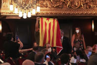 """A man holds an """"estelada"""" or Catalan pro-independence flag during a speech of Spain's prime minister Pedro Sanchez, not pictured, at the Gran Teatre del Liceu in Barcelona, Spain, Sunday, June 21, 2021. Sanchez's said Monday that the Spanish Cabinet will approve pardons for nine separatist Catalan politicians and activists imprisoned for their roles in the 2017 push to break away from Spain. (AP Photo/Emilio Morenatti)"""