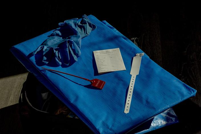 One of the blue body bags