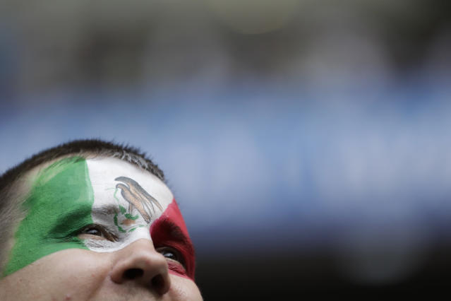 A Mexico fan waits for the start of the group F match between Mexico and South Korea at the 2018 soccer World Cup in the Rostov Arena in Rostov-on-Don, Russia, Saturday, June 23, 2018. (AP Photo/Lee Jin-man)
