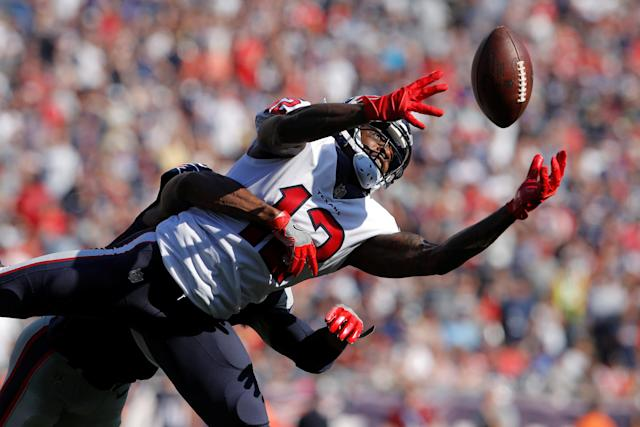 <p>Houston Texans wide receiver Bruce Ellington (12) makes the catch under pressure from the New England Patriots defense in the second half at Gillette Stadium. Mandatory Credit: David Butler II-USA TODAY Sports </p>