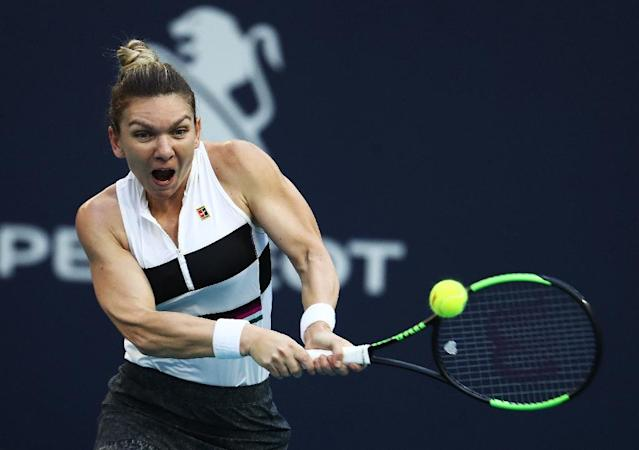 Simona Halep got the better of Venus Williams once again as the Romanian made light work of the 38-year-old American to book a place in the quarter-finals (AFP Photo/AL BELLO)