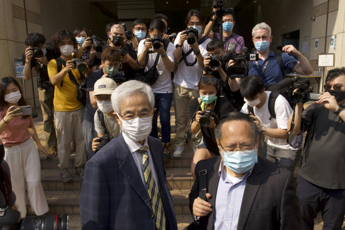 Pro-democracy lawmaker Martin Lee, left, and Albert Ho, right, arrive at a court in Hong Kong Thursday, April 1, 2021. Seven pro-democracy advocates, including media tycoon Jimmy Lai and veteran of the city's democracy movement Lee, are expected to be handed a verdict for organizing and participating in an illegal assembly during massive anti-government protests in 2019 as Hong Kong continues its crackdown on dissent. (AP Photo/Vincent Yu)