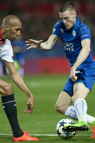 Sevilla's Steven N'Zonzi (L) fights for the ball with Leicester City's Jamie Vardy during their UEFA Champions League round of 16 1st leg match, at the Ramon Sanchez Pizjuan stadium in Sevilla, on February 22, 2017