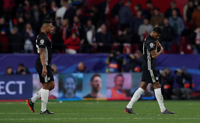 Soccer Football - Champions League Round of 16 First Leg - Sevilla vs Manchester United - Ramon Sanchez Pizjuan, Seville, Spain - February 21, 2018 Manchester United's Antonio Valencia and Marcus Rashford look dejected after the match Action Images via Reuters/Andrew Couldridge
