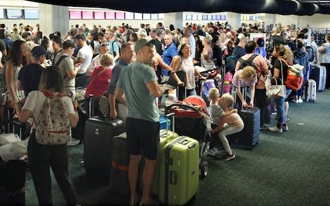 Departing passengers form a long queue to check in at Orlando International Airport ahead of the arrival of Hurricane Irma making landfall, in Florida - Credit: Reuters
