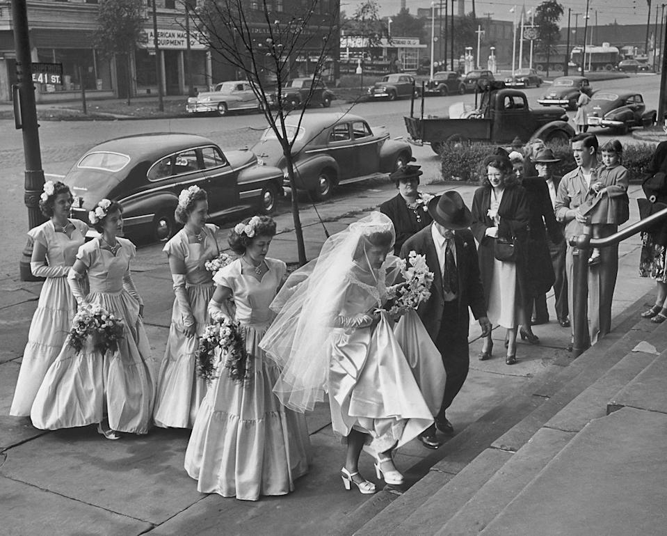 <p>Full skirt styles began popping up in bridal fashion by 1950. Sweetheart necks and cap sleeve gowns were some of the most popular styles you'd see walking down the aisle. </p>