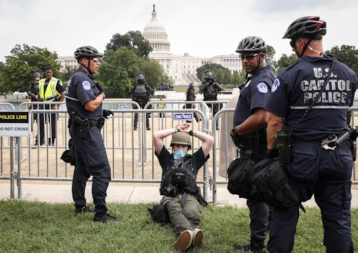 A person is detained by police for being in possession of a knife as supporters of those charged in the January 6 attack on the U.S. Capitol attend the 'Justice for J6' rally near the U.S. Capitol September 18, 2021 in Washington, DC.