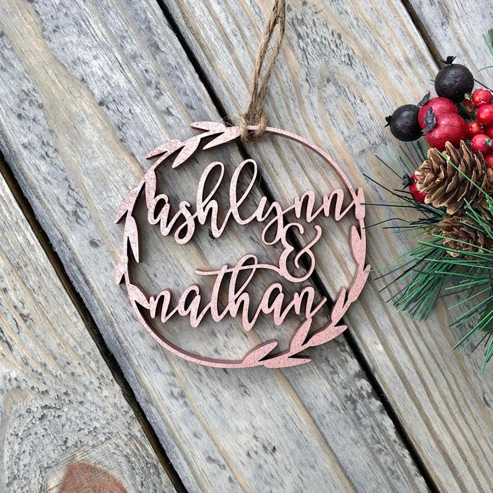 <p>A delicate <span>Personalized Christmas Ornament</span> ($18) adds a chic, rustic touch to any tree. </p>