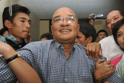 Prominent Myanmar comedian and vocal government critic, Zarganar (C), is welcomed by supporters upon his arrival at Yangon airport following his release from detention on October 12. Myanmar faced calls on Thursday to free its remaining political prisoners as the opposition expressed disappointment with a much-anticipated amnesty that left most key dissidents behind bars
