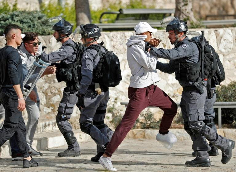 Israeli security forces scuffle with Palestinian protesters in Jerusalem's Old City on December 15, 2017