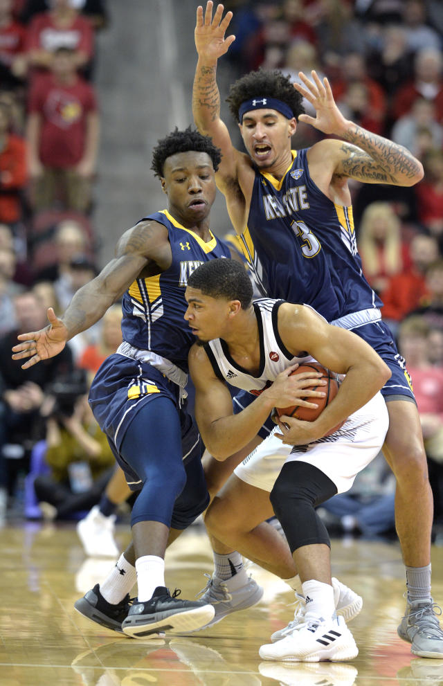 Kent State guard Antonio Williams (4) and forward Akiean Frederick (3) trap Louisville guard Christen Cunningham (1) during the first half of an NCAA college basketball game in Louisville, Ky., Saturday, Dec. 15, 2018. (AP Photo/Timothy D. Easley)
