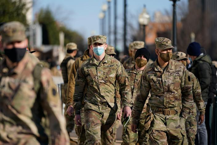 DC National Guard walk around the Capitol grounds, Jan. 7, 2021 in Washington.