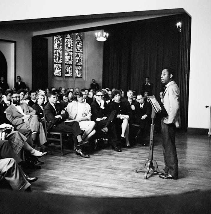 A group of African American jazz musicians and others listen to author and activist James Baldwin as he presented the group's views after a sermon at the American Protestant church in Paris, France, Aug. 28, 1963. The musicians threw their spiritual weight behind the March on Washington.