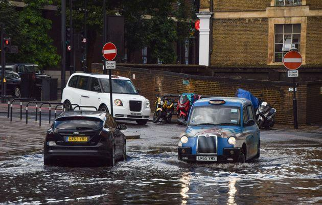 A taxi drives through a flooded Farringdon Lane in central London after a day of heavy rain in the capital in 2021 (Photo: SOPA Images via Getty Images)