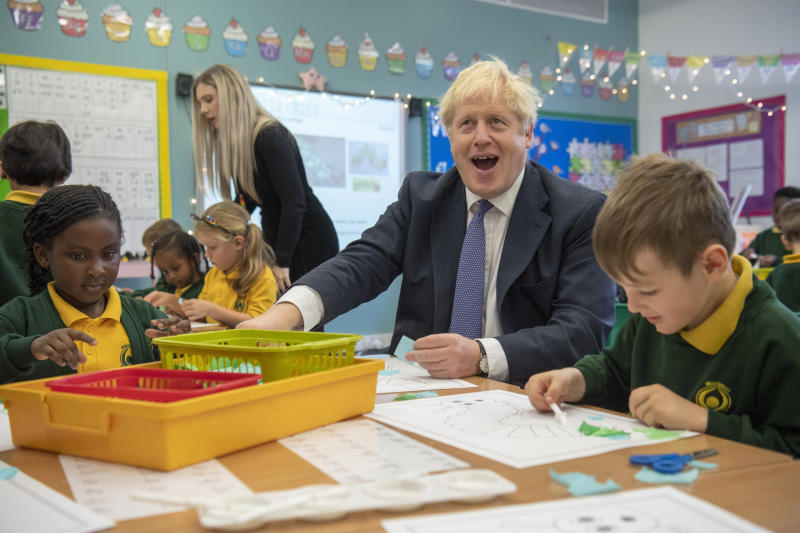Britain's Prime Minister Boris Johnson during a visit to Middleton Primary School in Milton Keynes, England, Friday Oct. 25, 2019. European Union ambassadors agreed Friday that the bloc should grant Britain's request for another extension to the Brexit deadline but have not yet figured out how long that delay should be. (Paul Grover/Pool via AP)