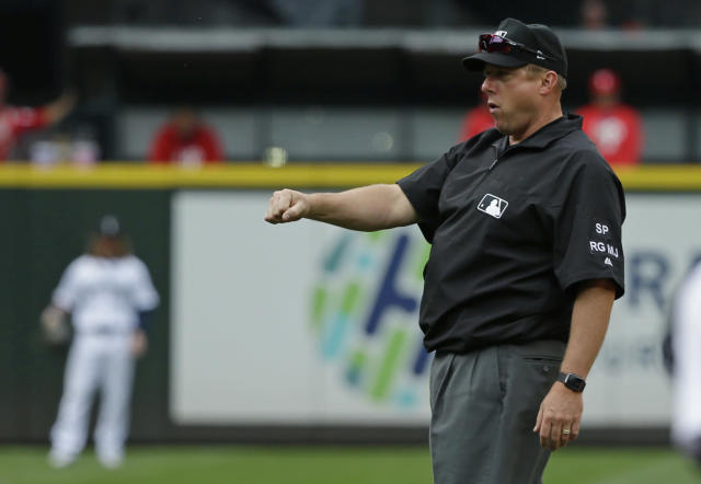 Umpire Bruce Dreckman pulled a giant bug out of his ear during Wednesday's Yankees-White Sox game and calmly went right back to work. (AP)