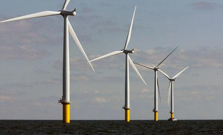 FILE PHOTO: Windmills turn in the breeze at Horns Rev 2, the world's largest wind farm, 30 km (19 miles) off the west coast of Denmark near Esbjerg September 15, 2009. REUTERS/Bob Strong/File Photo