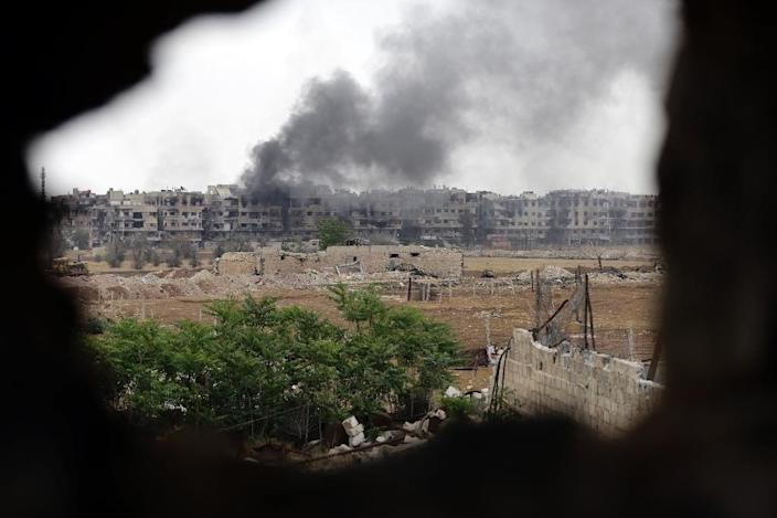 Syria's seven-year conflict has killed more than 350,000 people and displaced millions (AFP Photo/LOUAI BESHARA)