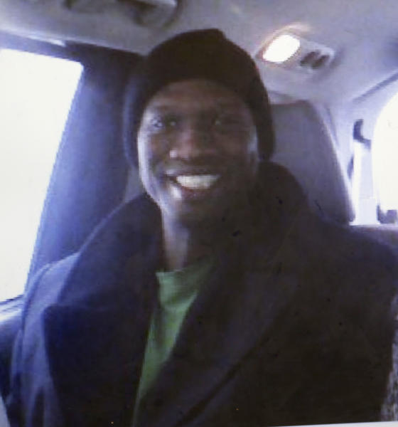 FILE - This undated cell phone photo provided by Kristi Kinard Suthamtewakul shows a smiling Aaron Alexis, the gunman in the Monday, Sept. 16, 2013 shooting rampage at at the Washington Navy Yard that killed 12, in Fort Worth, Texas. Alexis lied about a previous arrest when he applied for a security clearance in the Navy, and also failed to disclose thousands of dollars in debts, according to Navy report released Monday, Sept. 23, 2013. (AP Photo/Kristi Kinard Suthamtewakul, File)