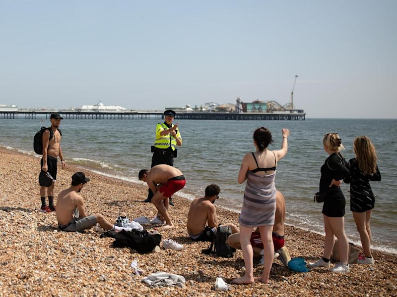 Crowds continue to gather on UK beaches despite lockdown and social distancing rules: Getty