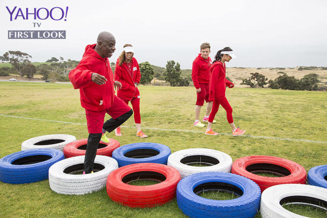 <p>Walker (<em>Good Times</em>) runs through tires as the rest of Team TV Kids cheers him on.<br><br>(Photo Credit: Kelsey McNeal/ABC) </p>