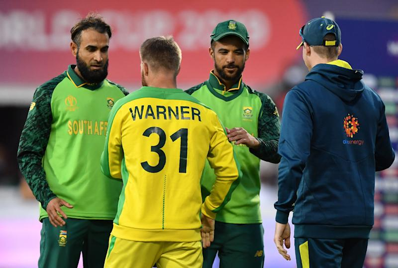 South Africa's JP Duminy (2R) shakes hands with Australia's David Warner (2L) as South Africa's Imran Tahir (L) and Australia's Steve Smith (R) on after victory in the 2019 Cricket World Cup group stage match between Australia and South Africa at Old Trafford in Manchester, northwest England, on July 6, 2019. (Photo by Paul ELLIS / AFP) / RESTRICTED TO EDITORIAL USE (Photo credit should read PAUL ELLIS/AFP/Getty Images)