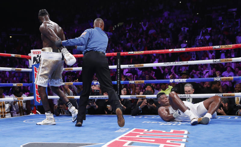 Deontay Wilder walks away after knocking down Luis Ortiz in a heavyweight title boxing match Saturday, Nov. 23, 2019, in Las Vegas. (AP Photo/John Locher)
