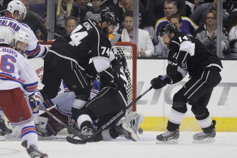 Los Angeles Kings right wing Justin Williams, right, scores a goal against the New York Rangers during the first period in Game 5 of the NHL Stanley Cup Final series Friday, June 13, 2014, in Los Angeles. (AP Photo/Jae C. Hong)