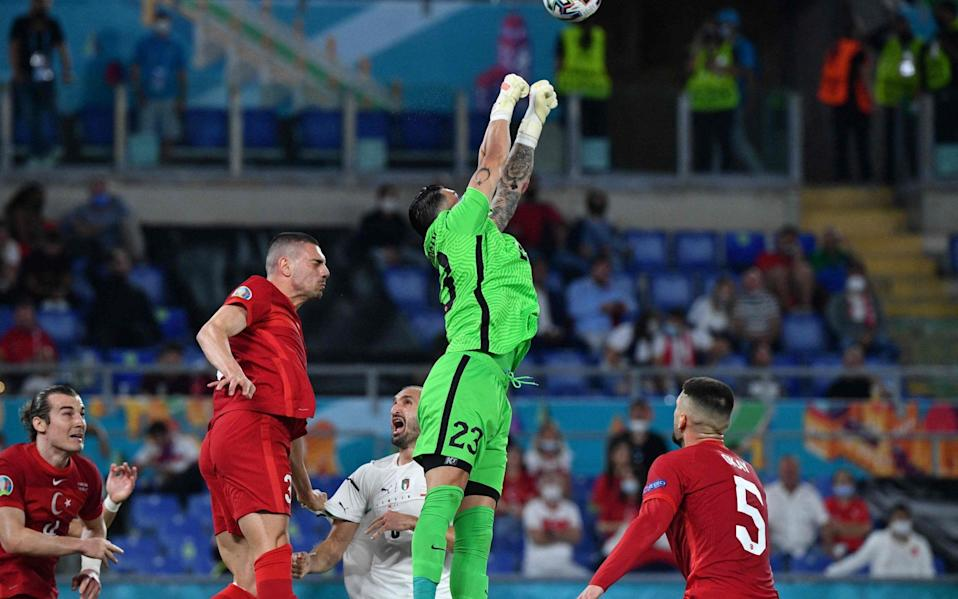 Turkey's goalkeeper Ugurcan Cakir jumps to clear the ball during the UEFA EURO 2020 Group A football match - AFP